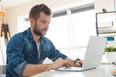 Get More Airbnb Cleaning Jobs, Man Working at Computer