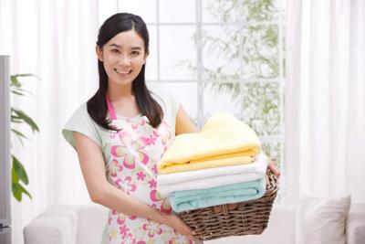 Property Management, Lady Holding Laundry Basket