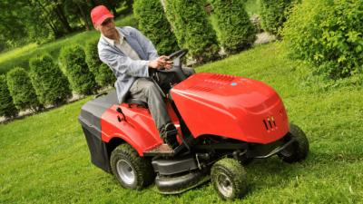 No Smoking landscaper on lawn mower