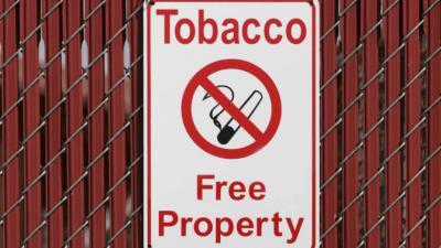 No Smoking smoke free property sign on fence